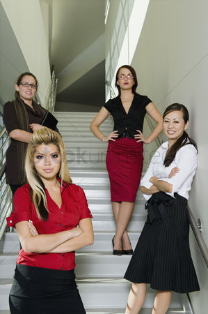 Staircase : Group of serious businesswoman on stairs low angle