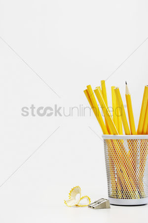 Background : Group of yellow pencils in holder by sharpener
