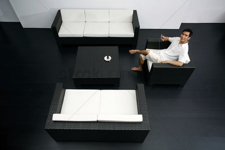 Tidy : Guy resting in a spacious living room