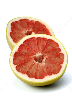 Beautiful : Halved grapefruit on white background