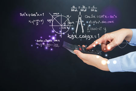 Count : Hand holding a calculator with science equation concept