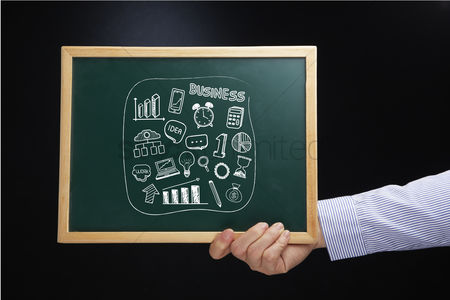 Handdrawn : Hand holding a chalkboard with business icons