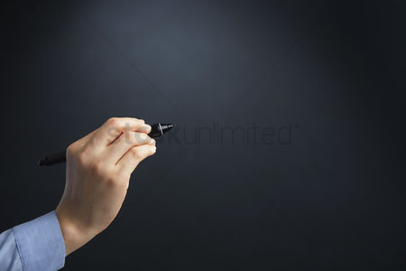Finger : Hand holding a digital pen