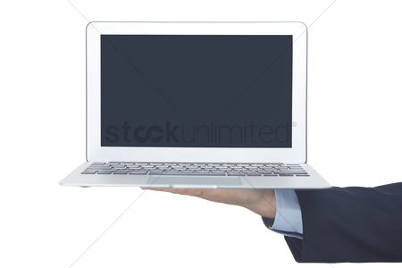 Finger : Hand holding a laptop
