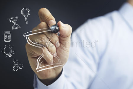 Match : Hand holding a marker pen with business time management concept