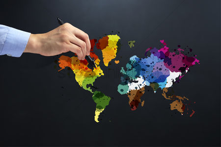 Flag : Hand holding a pen over colorful earth map