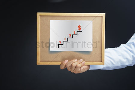 Stairs : Hand holding board with dollar sign on steps