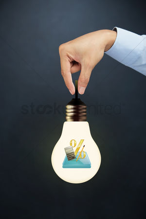 Grasp : Hand holding light bulb with financial calculation concept
