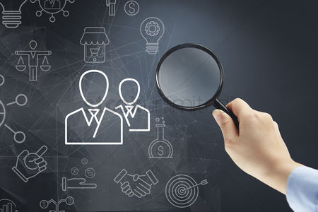 Magnifying glass : Hand holding magnifying glass to business cooperation concept
