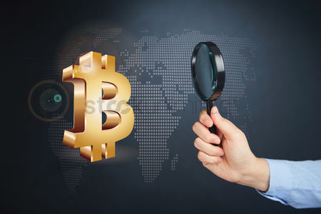 Magnifying glass : Hand holding magnifying glass with bitcoin currency symbol