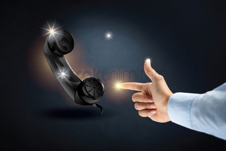 Sparkle : Hand pointing at telephone receiver concept