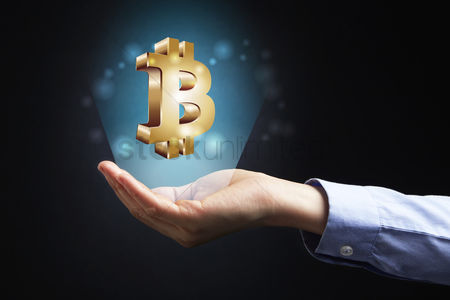Sparkle : Hand presenting bitcoin currency sign