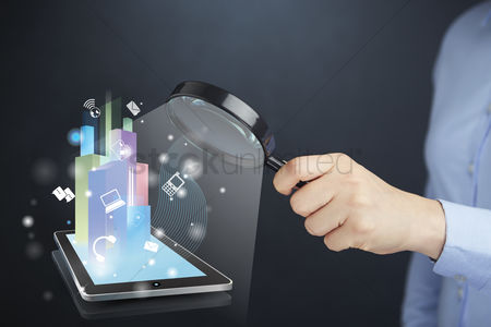 Devices : Hand presenting business diagram on tablet pc concept