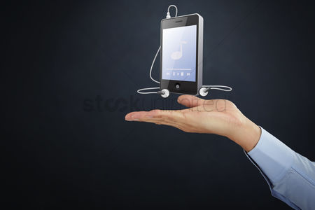 Earphone : Hand presenting mp3 player