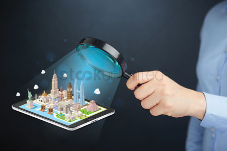 Glossy : Hand presenting world famous buildings model on tablet pc display concept