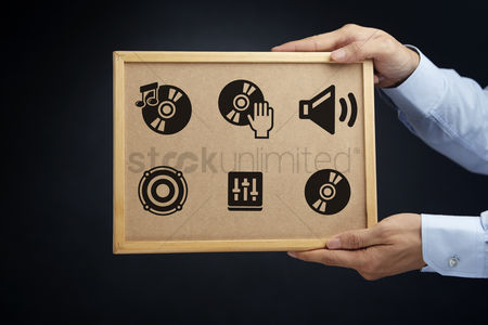 Vintage : Hands holding a board with audio concept