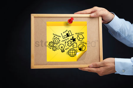 Cork board : Hands holding a board with business strategy concept