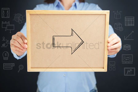 Handdrawn : Hands holding a cork board with arrow sign