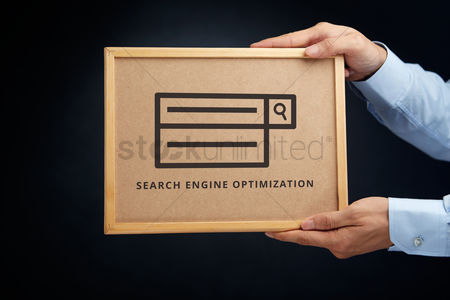 Show : Hands holding a cork board with search engine optimization concept