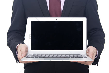 Devices : Hands holding a laptop