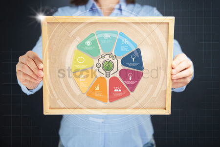 Cork board : Hands holding board with business success concept