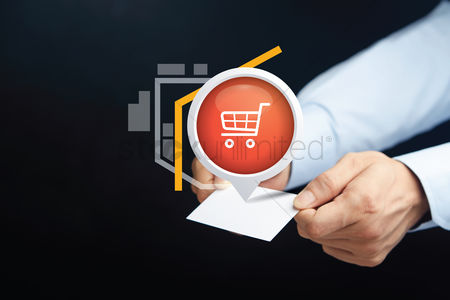 Shopping cart : Hands holding card with business and technology concept