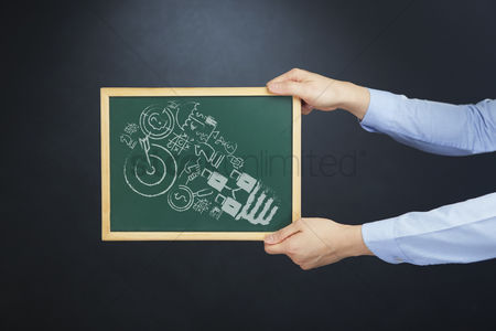 Handdrawn : Hands holding chalkboard with business concept
