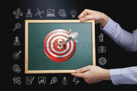 Sales person : Hands holding chalkboard with business target concept
