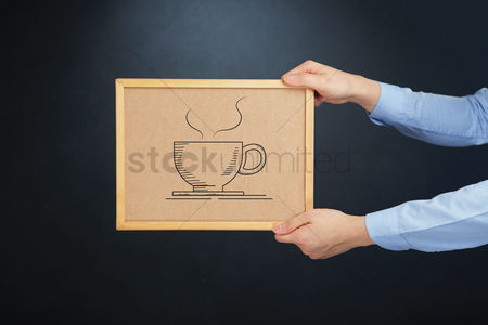 Cork board : Hands holding cork board with hot beverage concept