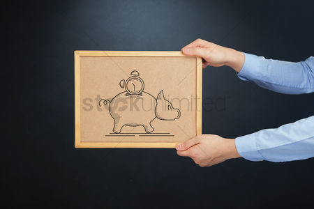 Cork board : Hands holding cork board with savings concept