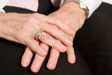 Sitting on lap : Hands of an elderly woman