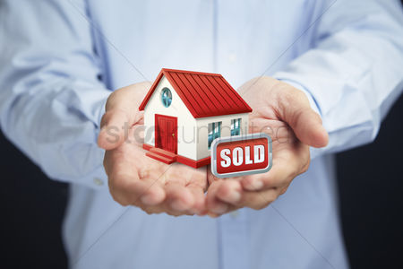 Finger : Hands presenting a sold house