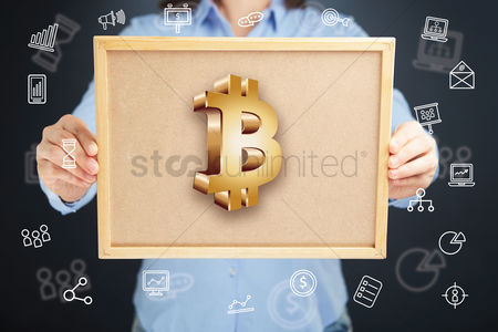 Client : Hands presenting bitcoin currency symbol on cork board concept