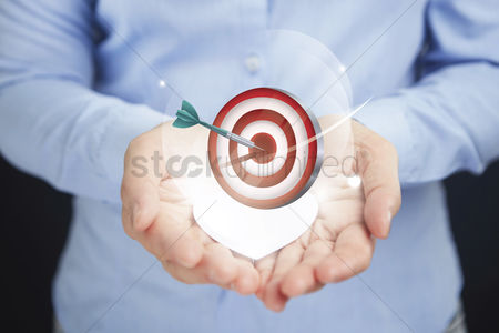 Heart shapes : Hands presenting business target concept