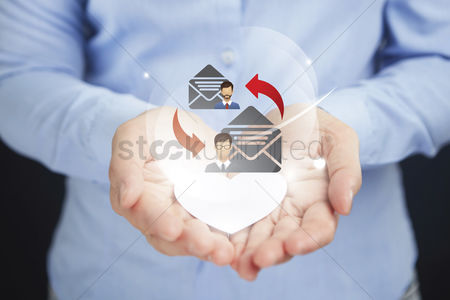 Heart : Hands presenting email marketing concept