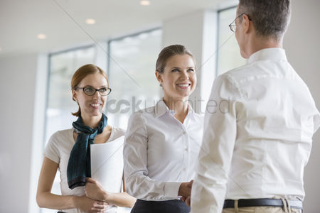 Office worker : Happy business people shaking hands in office