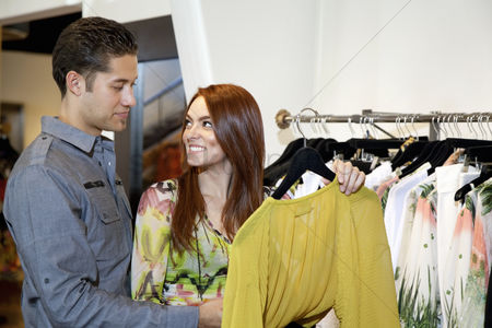 Selection : Happy woman with boyfriend looking at each other in fashion clothing boutique