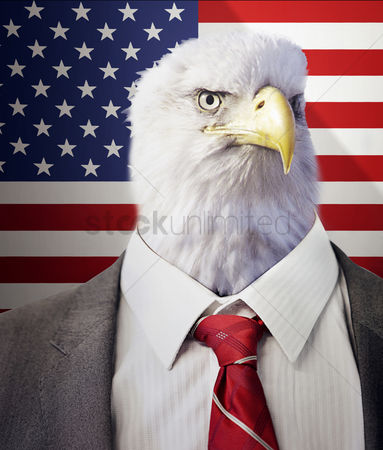 Us : Head of an eagle on a businessman s body in front of american stars and stripes flag