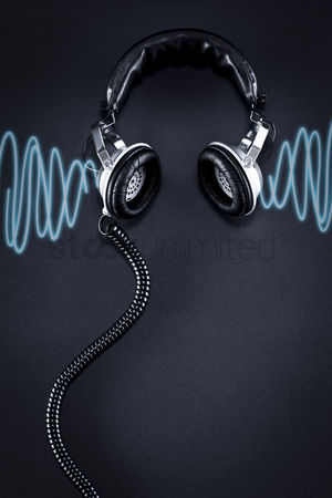 Technology background : Headphones over black background