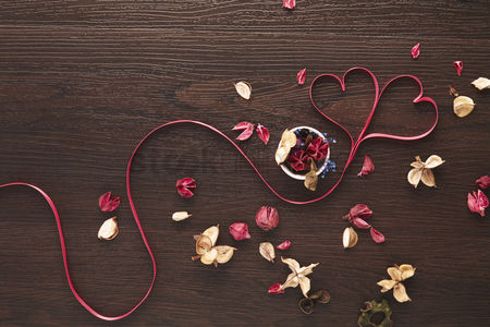 Conceptual : Heart shaped ribbon with dried flowers design