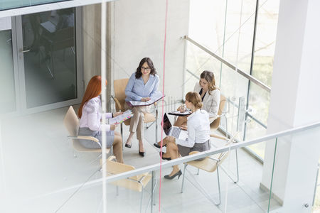 Young woman : High angle view of businesswomen discussing in office