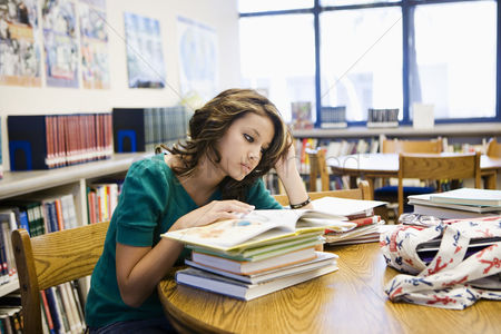 High school : High school student reading in library