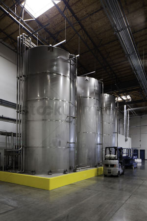 Forklift : Huge silos and a forklift at bottling plant
