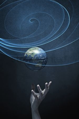 Blue background : Human hand reaching out for the globe