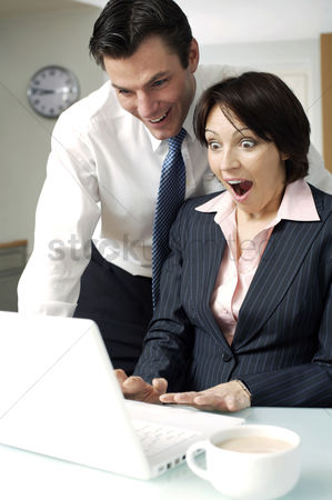 Food  beverage : Husband and wife looking at laptop with woman in shock