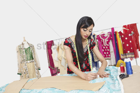 Traditional clothing : Indian female clothing designer working in design studio