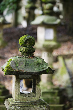 Weathered : Japan mara stone lantern in garden