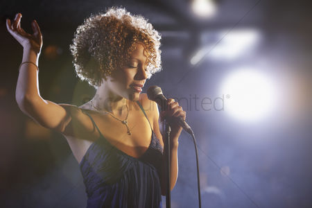 Arm raised : Jazz singer on stage portrait