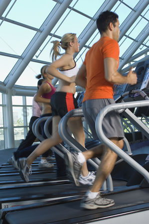 Fitness : Joggers on treadmills in gym