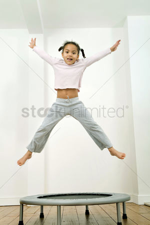 Curly hair : Kid jumping happily